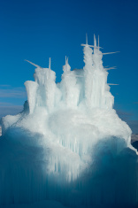 stock-photo-11798142-frozen-winter-ice-castle-rising-from-shadow-against-blue-sky