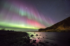 stock-photo-65413673-beautiful-green-and-red-aurora-dancing-over-skogafoss
